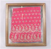A FRAMED AND GLAZED INDIAN SILK WORK with gold thread,
