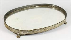 A BRASS FRAMED MIRRORED PLATEAU of oval shape with an