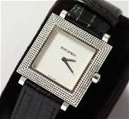 A VERY GOOD BOUCHERON 18K GOLD WRISTWATCH with leather