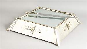 A SILVER PLATED ART DECO DESIGN MIRRORED CAKE STAND