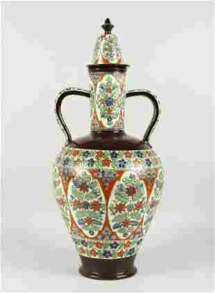 A LARGE TURKISH POTTERY TWO-HANDLED VASE AND COVER.