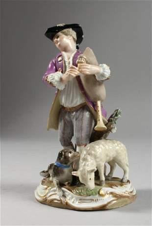 A GOOD MEISSEN PORCELAIN FIGURE OF A YOUNG MAN, playing