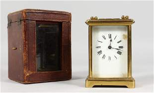 A GOOD FRENCH BRASS CARRIAGE CLOCK.  4.5ins, in a