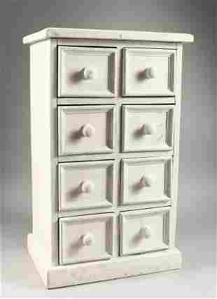 A PAINTED PINE TABLE TOP CHEST OF EIGHT SMALL DRAWERS,