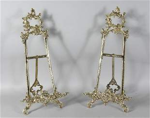 A GOOD LARGE PAIR OF BRASS EASELS.  20ins high.