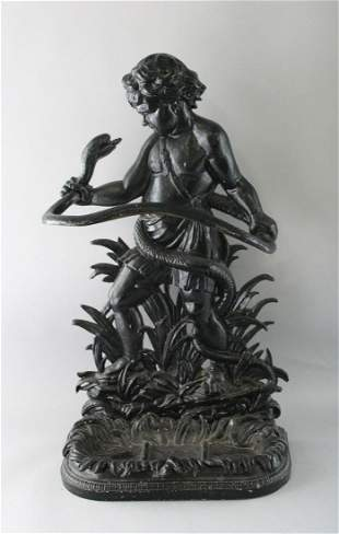 A LATE VICTORIAN CAST IRON STICK STAND, modelled as a