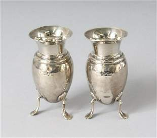A PAIR OF VICTORIAN SILVER VASES, in a fitted case.