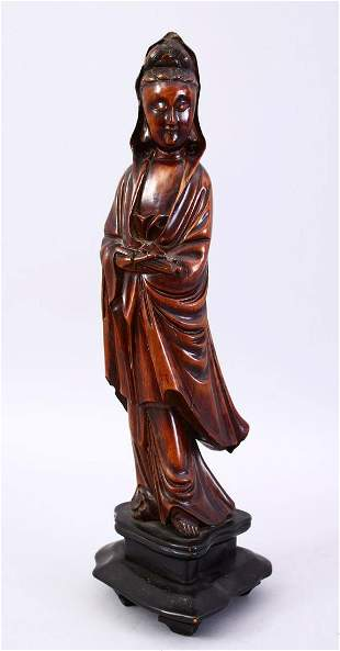 A GOOD JAPANESE MEIJI PERIOD CARVED WOOD OKIMONO OF