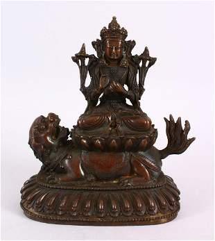 A TIBETAN BRONZE FIGURE OF BUDDHA / DEITY, in a seated