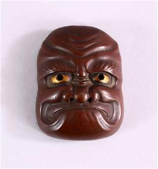 A JAPANESE MEIJI PERIOD BRONZE NOH MASK, with gilt eye