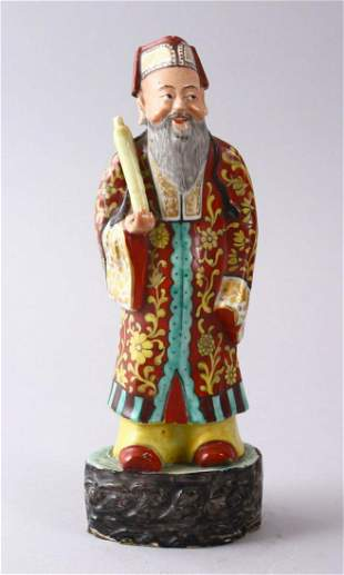 A CHINESE FAMILLE ROSE POTTERY FIGURE OF A SCHOLAR,