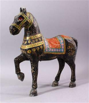 A KASHMIRI PAINTED CARVED WOOD MODEL OF A PRANCING