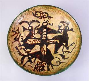 A GOOD EARLY ISLAMIC POTTERY DISH, decorated with