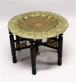 A GOOD LARGE ISLAMIC BRASS TRAY TABLE AND FOLDING