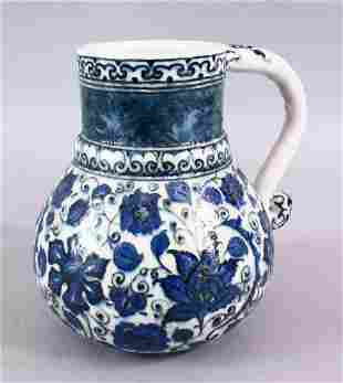 AN ISLAMIC BLUE & WHITE PORCELAIN WATER JUG, decorated