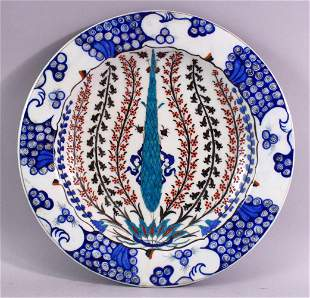 A GOOD LARGE IZNIK POTTERY DISH, the centre painted