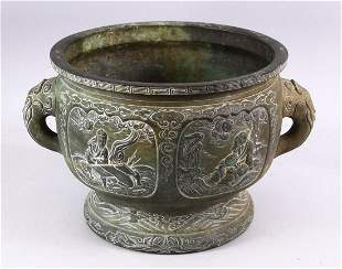 A 19TH CENTURY CHINESE BRONZE IMMORTAL TWIN HANDLED
