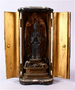 A 19TH CENTURY JAPANESE CARVED WOODEN ENCLOSED FIGURE