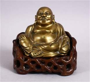 A 19TH CENTURY CHINESE BRONZE FIGURE OF BUDDHA & STAND,