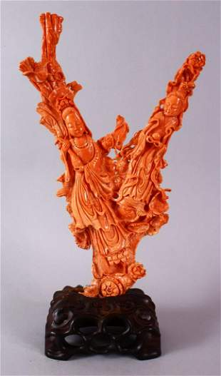 A 19TH CENTURY CHINESE CARVED CORAL FIGURE OF GUANYIN,
