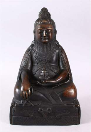 A CHINESE BRONZE CAST FIGURE OF DEITY OR BUDDHA, in a