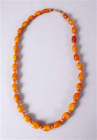A CHINESE CARVED AMBER AND CORAL BEAD NECKLACE, with