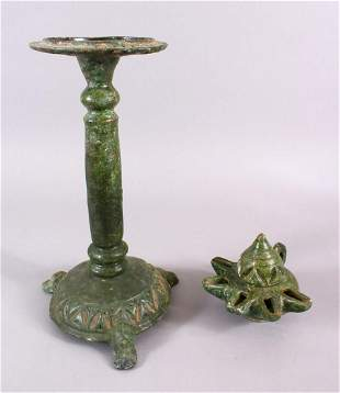 A UNUSUAL EARLY ISLAMIC POTTERY OIL LAMP ON STAND, 46cm