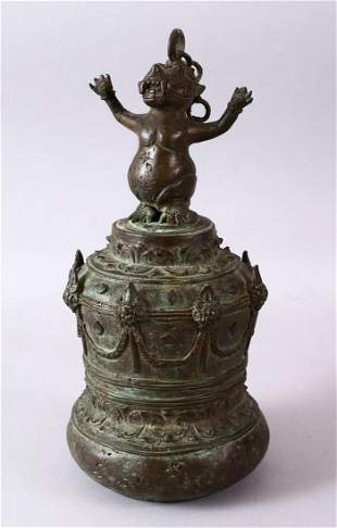 AN EARLY INDONESIAN BRONZE TEMPLE BELL, the top with a