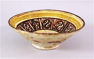 A 12TH CENTURY ISLAMIC / PERSIAN POTTERY BOWL, with