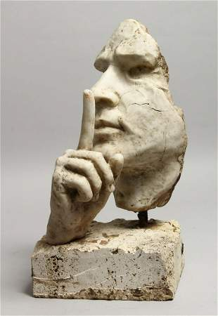AN ITALIAN CARVED WHITE MARBLE FACE WITH A HAND.  16ins
