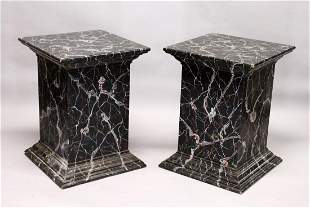A LARGE PAIR OF PAINTED FAUX MARBLE PEDESTALS.  2ft
