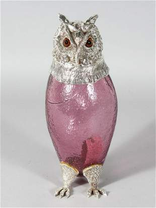 A GOOD PINK GLASS OWL CLARET JUG with plated head,