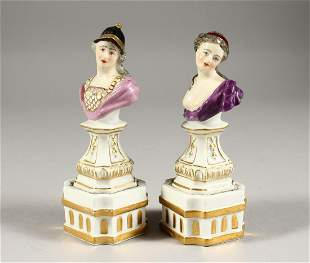 A GOOD SMALL PAIR OF DRESDEN BUSTS ON FIXED STANDS of a