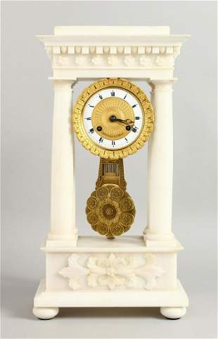 A SUPERB FRENCH EMPIRE WHITE ALABASTER PILLAR CLOCK by