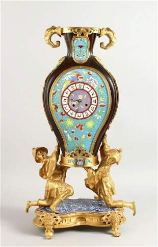 A FRENCH CLOCK, IN THE CHINESE MANNER, GILT BRONZE AND