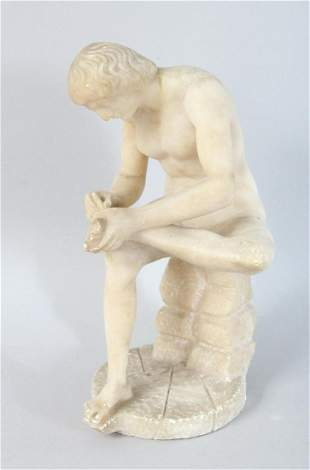 AN ITALIAN CARVED ALABASTER FIGURE, picking a thorn