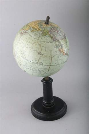 A G. THOMAS TERRESTRIAL GLOBE on a stand.  7.5ins