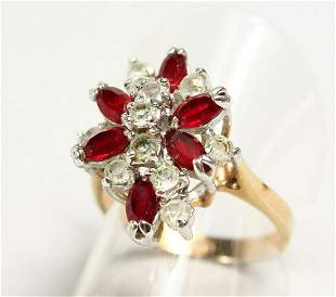 A 9CT GOLD MULTI-STONE RING.
