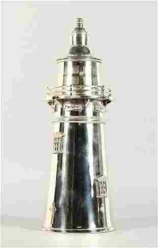 A LARGE SILVER PLATE LIGHTHOUSE COCKTAIL SHAKER.  14ins
