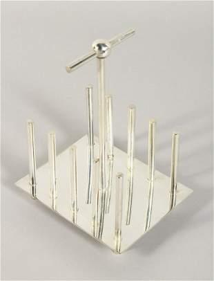 A CHRISTOPHER DRESSER DESIGN RECTANGULAR SHAPED TOAST