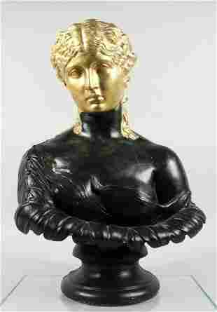A HEAVY PAINTED STONE BUST of a classical young girl. 1