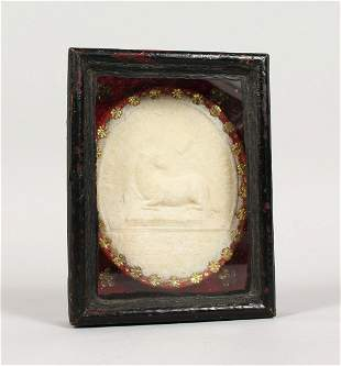 """A GEORGIAN OVAL PLAQUE, possibly wax  """"Lamb Of God"""" in"""