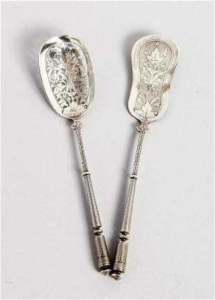 TWO CONTINENTAL SILVER SPOONS with pierced bowls, 6