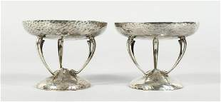 A PAIR OF HAMMERED SILVER SWEETMEAT  DISHES on three