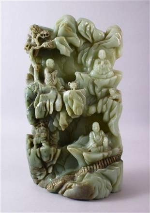 A LARGE AND HEAVY CHINESE CARVED JADE BOULDER - BUDDHA
