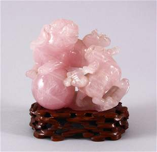 AN EARLY 20TH CENTURY CHINESE CARVED ROSE QUARTZ FIGURE