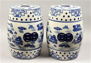 A PAIR OF CHINESE BLUE AND WHITE BARRELL SEATS 18ins