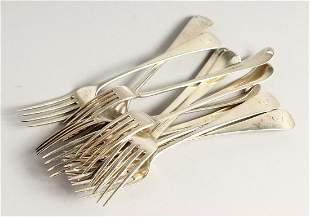 A SET OF TWELVE SILVER GEORGE III TABLE FORKS by Peter,