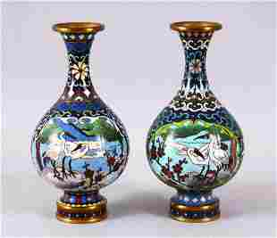 A PAIR OF CHINESE CLOISONNE CRANE VASES - each of the