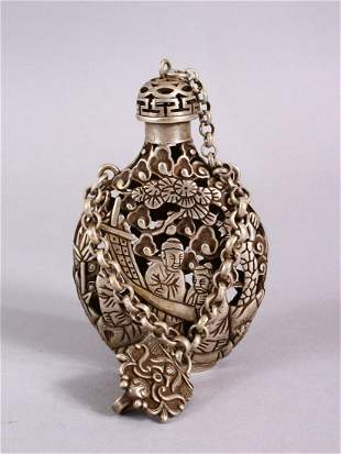 A CHINESE WHITE METAL OPENWORK SNUFF BOTTLE, with